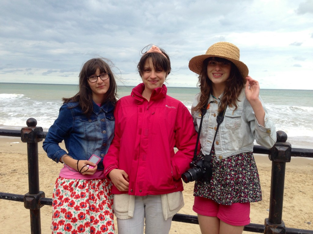 Mundeslely, North Norfolk. Hannah, Youth worker and two young students.